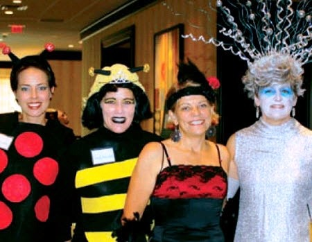 """Queen Bee"" Beth Peabody poses with ""Ladybug"" Ruth Trautwein and members of the Conservancy"